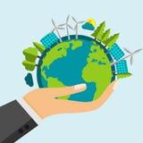 Apra la mano del fumetto che giudica il pianeta Terra riempito di natura verde e di fonti di energia rinnovabili Fotografia Stock Libera da Diritti