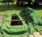 Apra la nuova tomba Immagini Stock