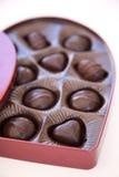 Apra la scatola di cioccolato di giorno del biglietto di S. Valentino Fotografia Stock