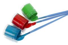Apra le latte di vernice e delle spazzole Fotografia Stock