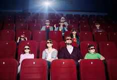 Apreciando o filme Imagem de Stock
