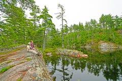 Apreciando um lago quieto Fotos de Stock