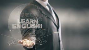 Aprenda al hombre de negocios inglés Holding del concepto del holograma a disposición ilustración del vector
