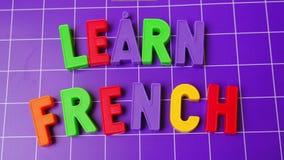 Aprenda el alfabeto de la lengua francesa en letras de los imanes almacen de video