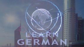 Aprenda el texto alemán con el holograma 3d de la tierra del planeta contra el contexto de la metrópoli moderna almacen de video