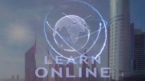 Aprenda el texto en línea con el holograma 3d de la tierra del planeta contra el contexto de la metrópoli moderna almacen de video