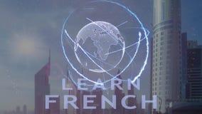 Aprenda el texto francés con el holograma 3d de la tierra del planeta contra el contexto de la metrópoli moderna almacen de metraje de vídeo