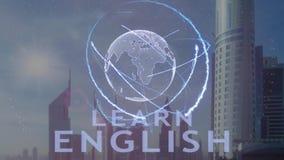 Aprenda el texto inglés con el holograma 3d de la tierra del planeta contra el contexto de la metrópoli moderna metrajes
