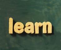 Aprenda la palabra en la pizarra - de nuevo a escuela Fotografía de archivo
