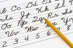 Aprendendo a escrita cursivo fotos de stock