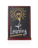 Aprendendo o alfabeto com ideia do bulbo no quadro Foto de Stock Royalty Free