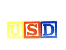 Aprendendo os blocos fazem a linha dos USD Fotografia de Stock Royalty Free