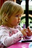 Aprendizaje de la niña Imagen de archivo libre de regalías