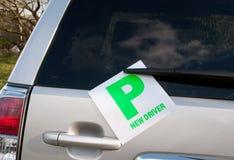 Aprendizaje de las placas en un coche Imagenes de archivo