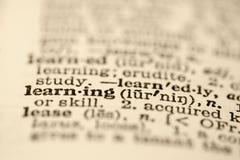 Aprendizaje en diccionario. Imagen de archivo libre de regalías
