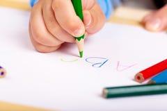 Aprendizaje escribir Imagen de archivo libre de regalías