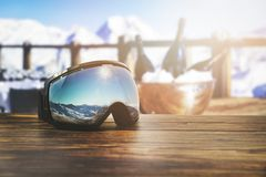 Free Apres Ski - Goggles With Mountains Reflection On The Restaurant Table At Ski Resort Stock Photos - 163279983