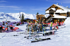 Apres ski in a mountain chalet bar, restaurant against panoramic view of Alps Stock Image