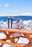 Apres ski in Sarikamis. Beautiful skier waiting for order in cafe on top of mountain Royalty Free Stock Image