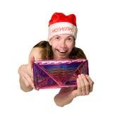 Apresentação engraçada do homem do Natal Imagem de Stock Royalty Free