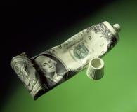Apretón de dólar americano en el tubo foto de archivo libre de regalías