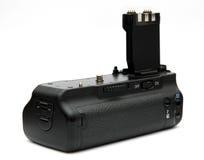 Apretón de la batería de la cámara de DSLR Fotografía de archivo