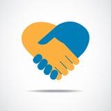 Apretón de manos bajo la forma de corazón Imagenes de archivo