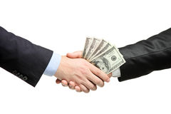 Apretón de manos con el dinero foto de archivo