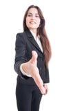 Apretón de manos de ofrecimiento de la mujer de negocios con el foco selectivo a mano Fotos de archivo libres de regalías