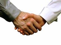 Apretón de manos del asunto, mujer y hombre (fondo gris) Foto de archivo libre de regalías