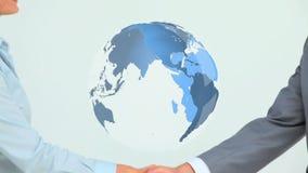Apretón de manos en el acuerdo del negocio global metrajes