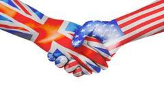 Apretón de manos entre los Estados Unidos de América y Reino Unido Foto de archivo libre de regalías