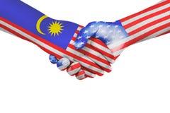 Apretón de manos entre Malasia y los Estados Unidos de América Fotos de archivo