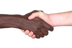 Apretón de manos interracial Foto de archivo