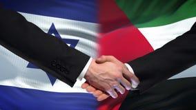 Apretón de manos de Israel y de Palestina, política internacional de la amistad, fondo de la bandera almacen de video