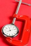 Apretón y reloj del tornillo Foto de archivo