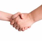 Apretón de manos del hombre y de la mujer aislado en blanco Imagen de archivo