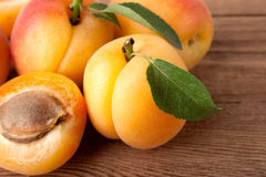 Apricot. Fresh apricot with leaf on a wooden board Stock Photo