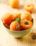Apricot. Group of ripe juicy fruit apricot on a green bowl Stock Image