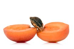 Apricot. Sliced apricot over white background Royalty Free Stock Photo