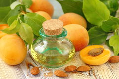 Apricot aroma oil. And fresh fruit stock photo