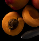 Apricot on a black stone Royalty Free Stock Images
