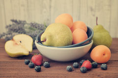 Apricot, blueberry and pear Stock Image