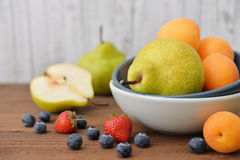 Apricot, blueberry and pear Royalty Free Stock Photos