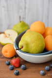 Apricot, blueberry and pear Stock Photography