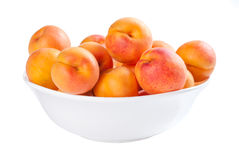 Apricot in bowl Stock Photos