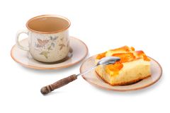 Apricot cake and cup of tea. Royalty Free Stock Image