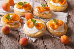 Apricot cake with sweet cream close-up on the table. Horizontal Stock Photo