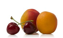 Apricot and cherries. Apricots and cherries isolated  over white background Stock Photos