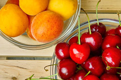 Apricot and cherry Stock Images